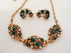 Vintage Emerald Green Rhinestone and Faux Pearl Necklace and Earring Set by Smallstones on Etsy https://www.etsy.com/listing/232044016/vintage-emerald-green-rhinestone-and