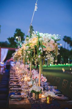 Flora Farm Whimsical wedding planned by Allure Events | Floral Design by Lola del Campo Florenta Gold candelabras with white cream flowers