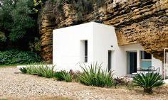 The Cuevas del Pino estate, designed by UMMO Estudio is a 104-meter-square home built into calcarenite stone caves near Córdoba, Spain