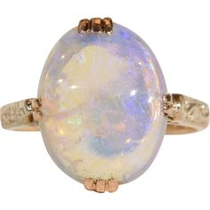 Opals look best at twilight, I don't know why, but the light from the setting sun seems to bounce around inside them and bring out the myriad of