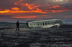 An old plane wreck on Sólheimasandur in Iceland with the infamous Eyjafjallajökull in the background.