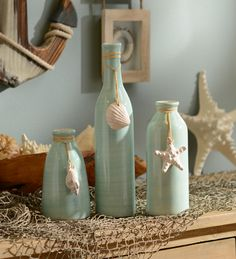 We love the seafoam green finish and the ivory seashell pendants of this set of Coastal Charm Vases! Add a beach vibe to your home and start experiencing the relaxation.