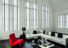 White wooden blinds with black tapes in a black and white room.