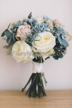 Large cream and dusty pink roses with diamonte detail, silver english lavender, dusty miller and eucalyptus // Bridal bouquet in creams and blues #weddings #wedding #marriage #weddingdress #weddinggown #ballgowns #ladies #woman #women #beautifuldress #newlyweds #proposal #shopping #engagement