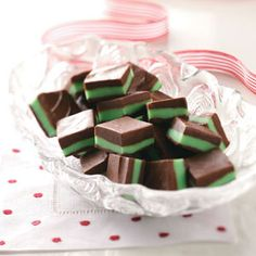 Peppermint Christmas Candy 1 cup semisweet chocolate chips, 1 can (14oz) sweetened condensed milk, divided,1 cup white baking chips, 3 tsp peppermint extract, 2 to 3 drops green food coloring