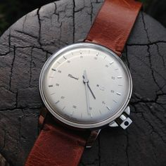 The Miansai M12 has a Swiss-made quartz movement and comes with a premium Italian Vintage leather strap. • Swiss made• Ronda movement . Stainless steel case . Domed Acrylic Crystal•. Silver curved dial. 3ATM. 39 mm Diameter Case, 6 mm thick. Please allow 1-2 weeks for shipping.