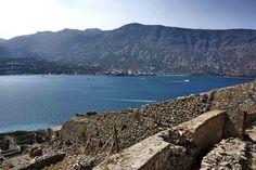 This day trip to Spinalonga Island had one aim: exploring the past of a fortified islet which served a variety of roles over the centuries. Greek Islands, Day Trip, Greece, The Past, Explore, Mountains, Country, Beach, Water