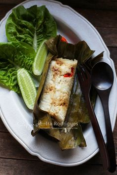 Arem-arem - coconut rice with filling wrapped in banana leaf