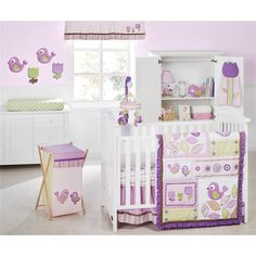 Your new baby girl will rest peacefully amidst softly colored purple, green and taupe leaves, tulips and sweetly chirping birds.