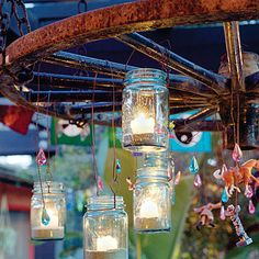 Eclectic chandelier  For a festive ambience, hang little white string lights from arbors or suspend an outdoor chandelier over a patio table. This one was made by hanging vintage canning jars, beads, and toys from a wagon wheel.