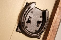 Horseshoe Light Switch Plate - could totally diy this.