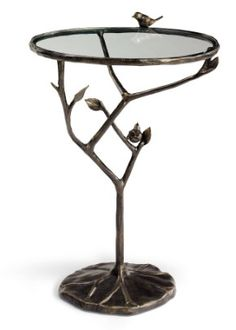 This charming Bird and Branch Table can stay outside year-round without worry.