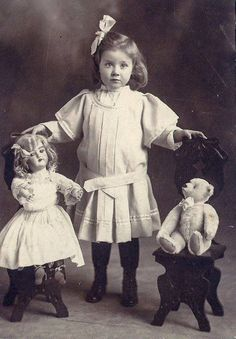 Adorable child with Doll and Teddy Bear