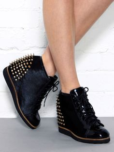 I seriously need these. Jeffrey Campbell | Edea Spike Studded Wedge Sneaker by Jeffrey Campbell