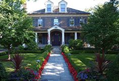 This gorgeous front yard has us longing for spring and warmer weather... client James Martin Associates can make it feel like spring everyday by filling your front yard with colorful flowers and gorgeous landscaping.  To learn more about their services visit http://www.jamesmartinassociates.com/.