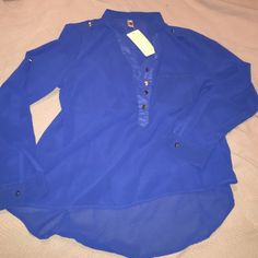 Royal Blue Shiffon blouse Royal blue Shiffon blouse. Short up front, long in the back look. Wear as a 3 quarter length or as a long sleeve shirt. Good buttons in the front and on the shoulders. Size L fits like a M Tops Blouses
