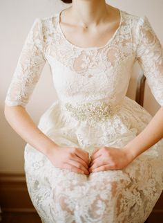 Short dress with lace overall that I believe is floor length, elbow length sleeves with scoop necklace, solid dress piece has a sweetheart neckline, color champagne, with beading detail at waist