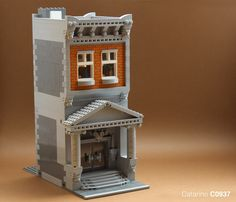 My first attempt at a modular building in real bricks! Done for a contest in my LUG (Comunidade0937). Hope you guys like it :) I'm kinda proud of the photography work on this one. Probably my best photos so far. Would you guys agree?