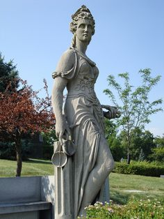 Themis, Greek Goddess of order, social control and Justice.