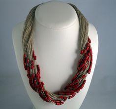 Necklace red linen thread purple orange green wood beads knots braid metal closure mediterranean style handmade. €19.99, via Etsy.
