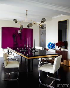 The dining room in Ivanka Trump and Jared Kushner's Manhattan apartment features a Lindsey Adelman light fixture, a custom-made table, and Mies van der Rohe chairs. Eric Piasecki  - ELLEDecor.com