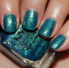 """NYX Nail Polish """"Be Jeweled""""- is a medium blue base, jam-packed with blue, green and gold glitter. This is SO PRETTY in person you must see it. I love that the base is really nicely opaque and it's soincrediblyglittery! This was two coats."""