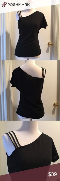 UO NWOT One shoulder black top Lux brand from Urban Outfitters. One shoulder tee shirt blouse top. Straps on one side and dolman style short sleeve on other. Lighter weight knit. A little bit sheer. Size medium. 16.5 inches across chest. 23 inches long. Urban Outfitters Tops Blouses