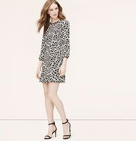 """Petite Wild Cat Flippy Dress - We're feeling untamed attraction towards this animal-spotted charmer. Jewel neck. 3/4 sleeves. Piped trim at neckline and cuffs. Back zip. 18 1/2"""" from natural waist."""