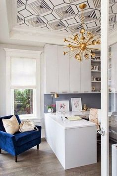 wallpapered ceiling and gold sputnik chandelier