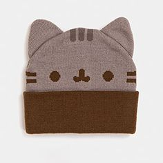 What's better than a marshmallow for a hat? Or a super fancy top hat? Pusheen for a hat! Warm, soft, heavyweight acrylic beanie features the face of Pusheen, with kitty-cat ears! (What other kind of ears would they be?)