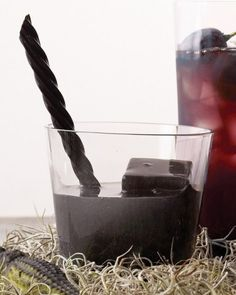 Black Lagoon Cocktail - Poison your party guests with a lemony vodka libation garnished with black ice cubes and a licorice stick.
