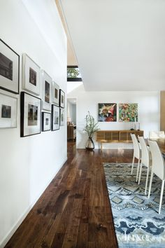 Contemporary White Dining Room with Gallery Wall