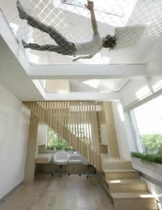 Insanely Clever Remodeling Ideas For Your New Home Have extra tall ceilings? Stretch a ceiling hammock across it.Have extra tall ceilings? Stretch a ceiling hammock across it. Deco Design, Design Case, Design Trends, Future House, Interior Architecture, Interior And Exterior, Interior Ideas, Installation Architecture, Modern Interior