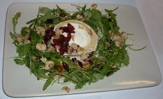 goat cheese with rucola, almond flakes and cranberry