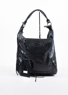 "Black leather ""Day"" shoulder bag with light glaze. Rolled top handle with lacing. ""Classic"" aged brass toned hardware. Front zippered pocket. Zips closed across top. Black textline lined interior feat"