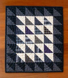 """One of my favorite NPR radio programs, """"The Story,"""" recently featured a guy named Chris McNaught, who is determined to pare his poss. Small Quilt Projects, Quilting Projects, Longarm Quilting, Scrappy Quilts, Mini Quilts, Baby Quilts, Two Color Quilts, Plaid Quilt, Half Square Triangle Quilts"""