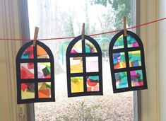 Stain glass church window craft. Used colored tissue paper on sticky contact paper. Window is from Ellison dye cut machine.