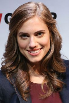 Whether your fancy blowout made it through the week or you have time to hit the salon, try soft ringlets like Allison Williams. We love how the front pieces are subtly twisted back.