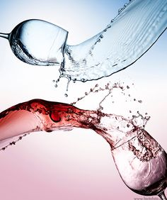 Splashes of glasses of water and wine