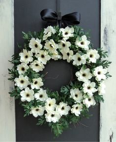 This elegant Anemone wreath is perfect for someone who loves black and white. While this wreath maybe casual it will look right at home on a