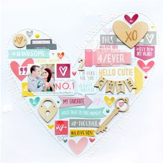 """""""Love You Always"""" scrapbook layout by Paige Evans, featuring giant heart from collaged elements."""