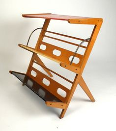 Rare 1950s Magazine Rack or Newspaper Holder | From a unique collection of antique and modern magazine racks and stands at https://www.1stdibs.com/furniture/more-furniture-collectibles/magazine-racks-stands/