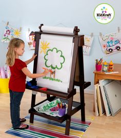 Creativity, functionality and style come together in KidKraft's Deluxe Wood Easel in Espresso. With classic lines that will enhance any room or play setting, KidKraft's Deluxe Wood Easel will bring out your child's inner-artist. Features Include:  Two patented anti-spill paint cups Paper dispenser with easy refill capability Whiteboard Chalkboard Useful trays for storing chalk, crayons, markers, and other art supplies Ages: 3+ Years Materials: Birch, MDF, chalkboard, laminate, plastic…