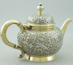 """Antique French Sterling Silver Tea Pot - As hallmarks we have the French Minerva No.1 mark (twice), which guaranteed .950 purity sterling silver used in Paris since 1838. The maker's mark is that of Emile Hugo, rue des Quatre-Fils, active in Paris 1853-1880, among the mark """"CARDEILHAC"""", 4 rue Roule, then 91 rue de Rivoli. The Maison Cardeilhac was founded in 1804 by Antoine-Vital Cardeilhac, specialized in silver cutlery and tableware."""