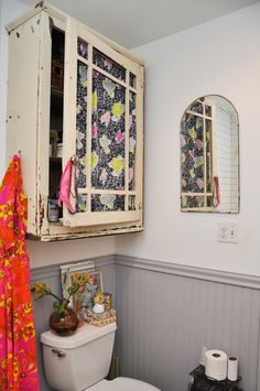 Love the fabric inside the cabinet door, and mirror, and clutter on the cistern!  The home of Emily Henson, via Apartment Therapy