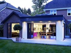 This open plan kitchen design is both modern and in keeping with the original style of it's host property. Folding sliding doors allow both wings to be opened onto the garden entirely whilst filling the rooms with light. The large skylight situated within Orangerie Extension, Extension Veranda, Glass Extension, Roof Extension, Extension Ideas, Extension Google, Conservatory Extension, Conservatory Ideas, Bungalow Extensions
