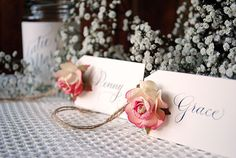 Paper rose place names £2.50 each including handwritten calligraphy, paper roses and jute twine