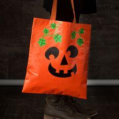 Duck Tape® brand duct tape DIY pumpkin trick-or-treat bag.