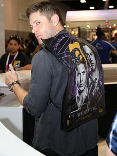 .@JensenAckles looking boss in his #Supernatural official Comic-Con bag/backpack in the WB booth @ Comic-Con 2015.