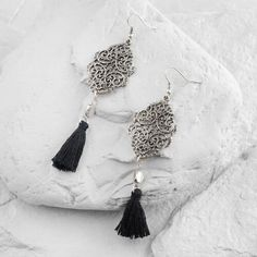 Inspired by the age of Art Deco, these tantalizing silver filigree drop earrings make a vintage style statement with gorgeous black cotton tassels.